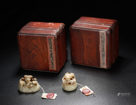 A PAIR OF ARCHAIC WHITE JADE SEALS WITH HUANGHUALI BOXES