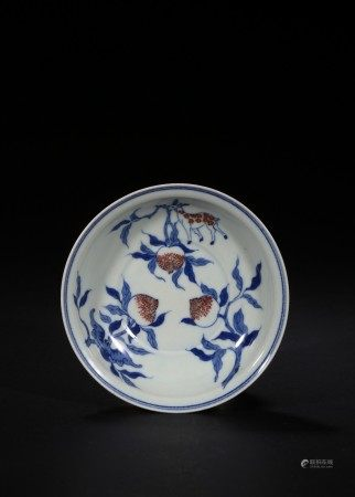 A BLUE AND WHITE RED GLAZED 'PEACH DISH