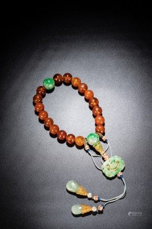 A CHINESE AMBER AND JADEITE ROSARY BRACELET