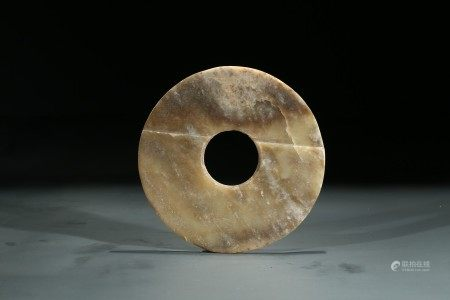 A CELADON JADE CARVED DISC