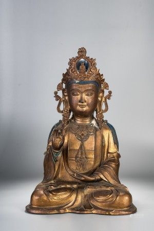 A LARGE GILT BRONZE SEATED FIGURE OF GUANYIN