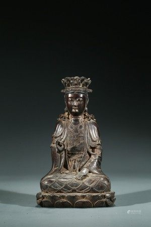 A CHINESE PARCEL-GILT BRONZE FIGURE OF SEATED GUANYIN