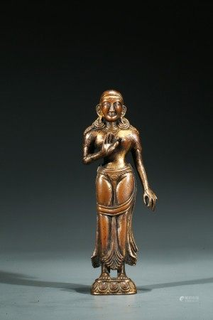 A COPPER ALLOY FIGURE OF STANDING FIGURE