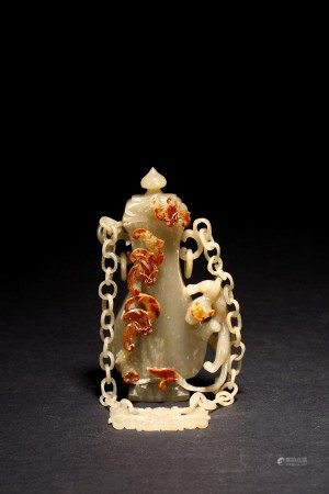 A CARVED JADE HANGING VASE