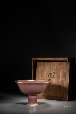 A CHINESE RED GLAZED INCISED STEM CUP