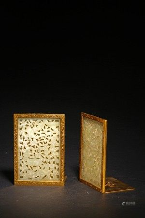 A PAIR OF WHITE JADE RETICULATED GILT BRONZE BOOKENDS