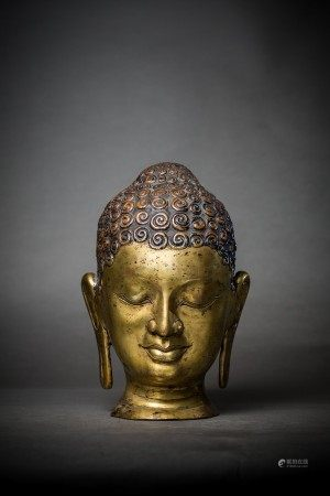 A GILT BRONZE BUDDHA HEAD