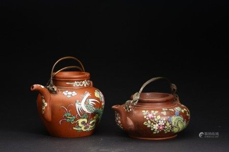 A SET OF TWO PAINTED YIXING ZISHA TEAPOTS