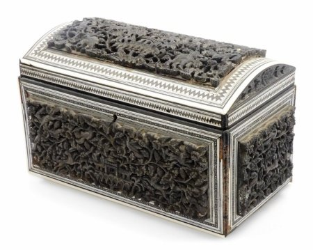 A 19thC heavily carved Anglo Indian padouk and sadeli double tea caddy, with domed top, with