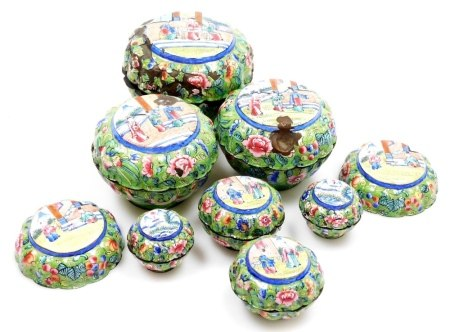 A graduated set of early 20thC Chinese Canton enamel jars and covers, each decorated with panels
