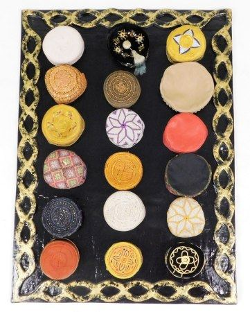 A collection of Kufi hats of various embroidered coloured design, (18), with a hand amde papier