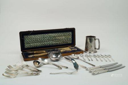 A collection of silver and silver plated wares, to include: a cased silver mounted carving set,