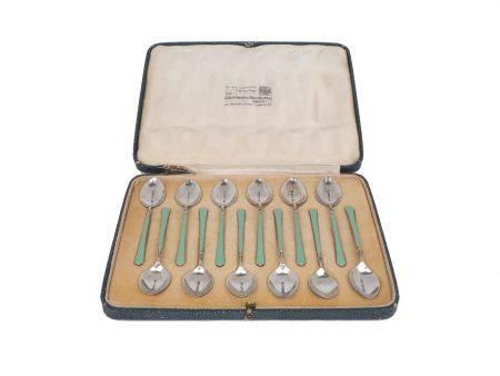 A cased set of twelve enamelled silver coffee spoons, Birmingham, c.1934, Turner & Simpson,
