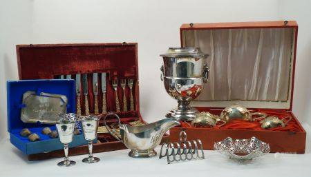 A silver plated wine cooler with lion mask handles, designed as an urn with removable section for