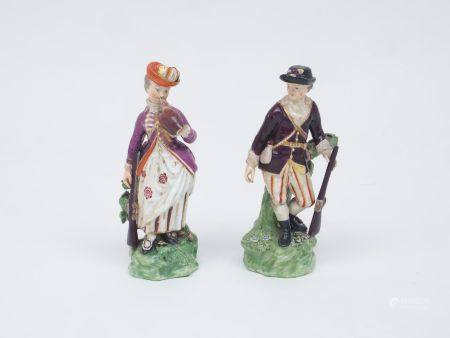 A pair of Derby porcelain figures, circa. 1775, designed as a huntsman and his female companion,