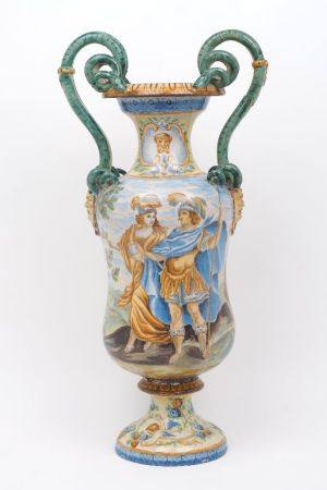 An Italian majolica twin handled urn form vase, late 19th century, with green snake form handles