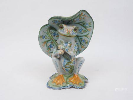 A Mosanic Faience pottery figure of a frog, early 20th Century, modelled seated sheltering under a
