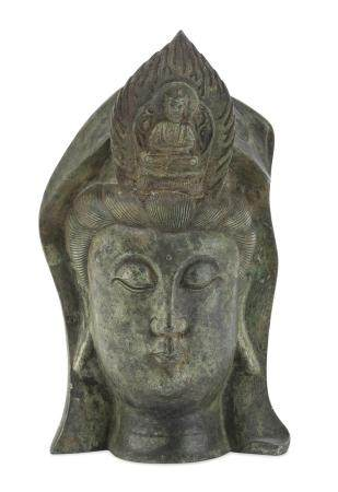 A CHINESE BRONZE HEAD DEPICTING GUANYIN. 20TH CENTURY.