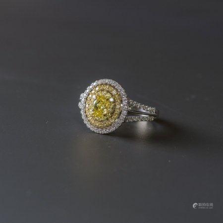 A FANCY COLOR DIAMOND RING, AIGL CERTIFIED