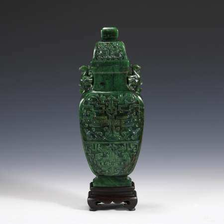 GREEN JADE CARVED RELIEFS LIDDED VASE ON STAND
