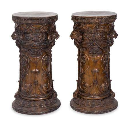 A Pair of Neoclassical Style Patinated Metal Pedestals Height 39 1/4 x diameter 18 1/2 inches.