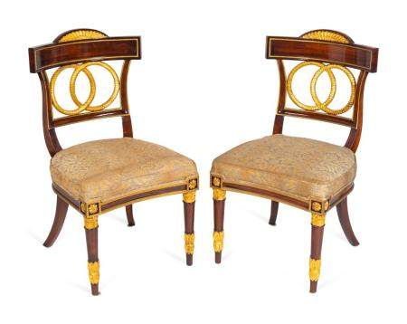 A Set of Four Russian Neoclassical Style Parcel-Gilt Mahogany Armchairs Height 36 1/2 x width 20 x depth 19 inches.