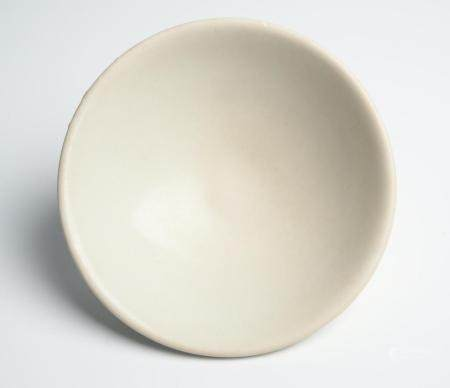 A CHINESE DINGYAO WHITE-WARE BOWL TANG DYNASTY (618-907)
