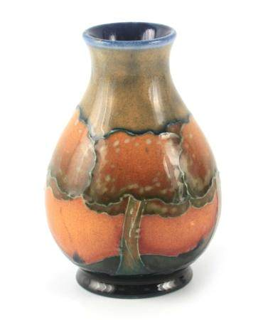 AN EARLY 20TH CENTURY MOORCROFT EVENTIDE LANDSCAPE VASE of baluster form, having a flared neck, 10cm