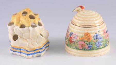 TWO PIECES OF 20TH CENTURY CLARICE CLIFF PORCELAIN comprising of a Honey Pot decorated with spring