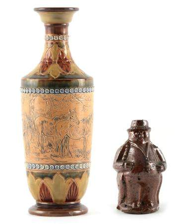 AN EARLY 20TH CENTURY DOULTON LAMBETH STONEWARE VASE BY HANNAH BARLOW decorated with horses having