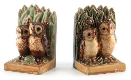 A PAIR OF EARLY 20TH CENTURY DOULTON LAMBETH STONEWARE BOOKENDS DESIGNED BY HARRY SIMEON each