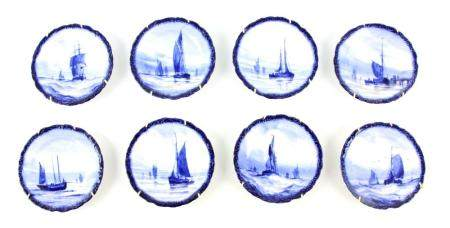 A SET OF EIGHT ROYAL CROWN DERBY SMALL HANGING PLATES painted with differing sailboats on a blue
