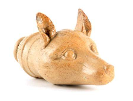 AN EARLY 19TH CENTURY STONEWARE FOX HEAD STIRRUP CUP 19cm overall.