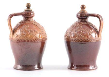 A PAIR OF LATE 19TH CENTURY DOULTON LAMBETH IRISH WHISKEY AND BRANDY DECANTERS with stoppers, having
