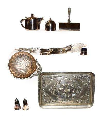 A tray of assorted silver plated wares including an Elkington & Co. hot water jug, two crumb scoops,