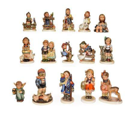 A tray of fifteen Hummel figures . Three figures with damage the rest in generally good condition