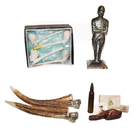 A tray of smoking related collectables including a pair of antler cigar cutters, table lighter