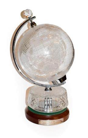 A Waterford cut glass table globe on an oak base bearing presentation plaque, 59cm high