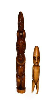 Two African vegetable ivory figures, Luba style, largest 34cm high (2)