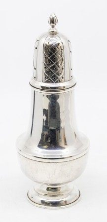 A George V large silver caster, plain baluster body, the domed cover with pieced decoration wyvern