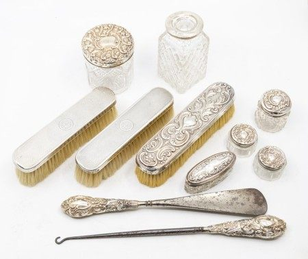 A collection of dressing table items to include silver topped table jars,  silver handled shoe