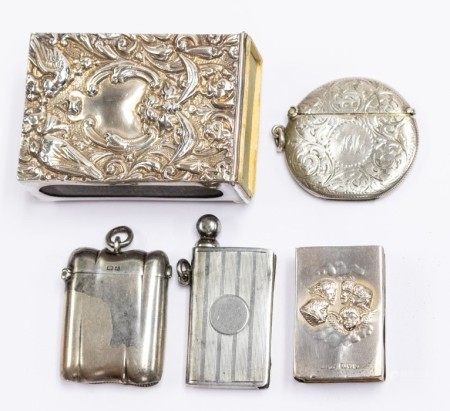 Three silver vesta cases, including circular engraved with foliate scrolls, WA, Birmingham 1906;