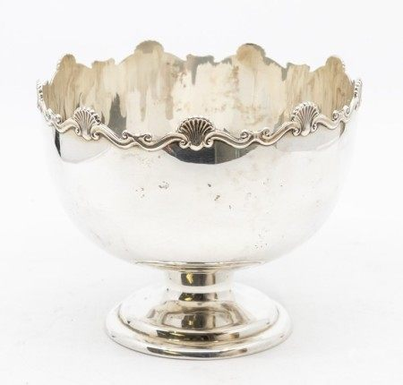 A George V silver rose bowl on stand, cast wavy rocaille and scroll border on raised foot, by Mappin