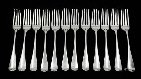 A set of twelve George III silver Old English Pattern table forks, the reverse handle engraved