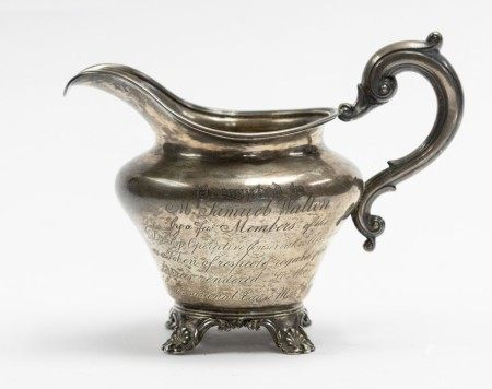 DERBY / POLICTICAL INTEREST: A Victorian silver presentation cream jug, ogee shaped on scroll