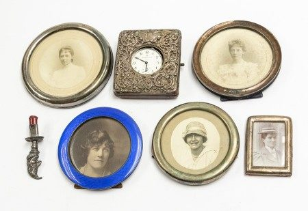 A group of silver to include: a late Victorian silver mounted watch mount, the cover applied with