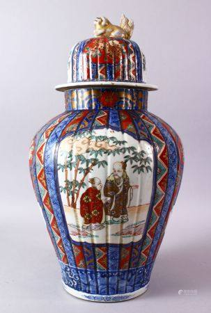 A LARGE IMARI VASE AND COVER, the ribbed body painted with panels of flowers and figures, the