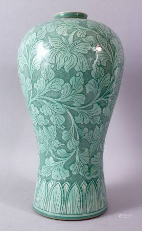 A LARGE KOREAN CELEDON VASE, the body with srolling foliage, signed, 38cm high.