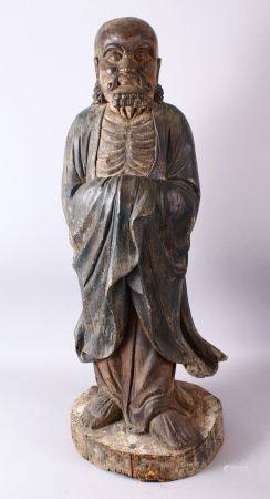 A 18TH/19TH CENTURY CHINESE CARVED WOOD FIGURE OF ROHAN, on a shaped base, 90cm high.