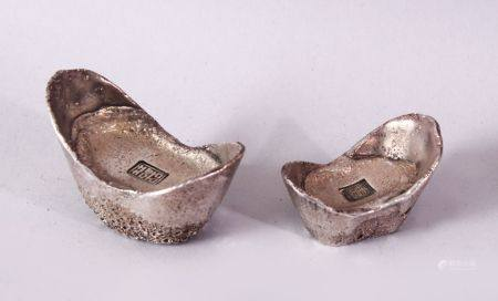 TWO PIECES OF CHINESE WHITE METAL POSSIBLY SILVER SHOE CURRENCY, 7cm and 6.5cm.
